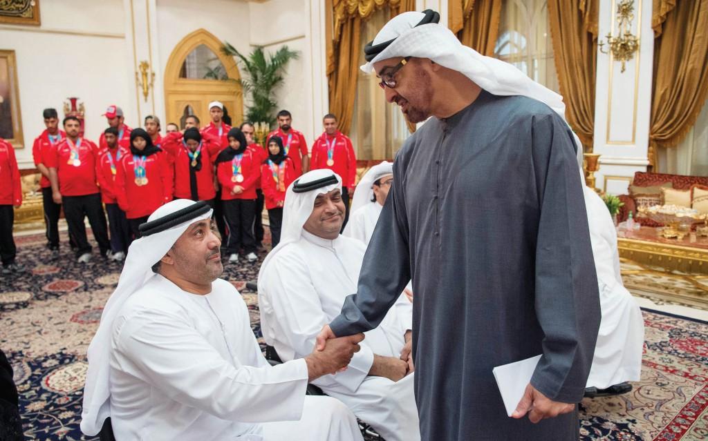 ABU DHABI, UNITED ARAB EMIRATES - January 11, 2016: HH Sheikh Mohamed bin Zayed Al Nahyan Crown Prince of Abu Dhabi Deputy Supreme Commander of the UAE Armed Forces (R), greets a member of the UAE Disabled Sports Federation during a Sea Palace barza. ( Rashed Al Mansoori / Crown Prince Court - Abu Dhabi ) ---